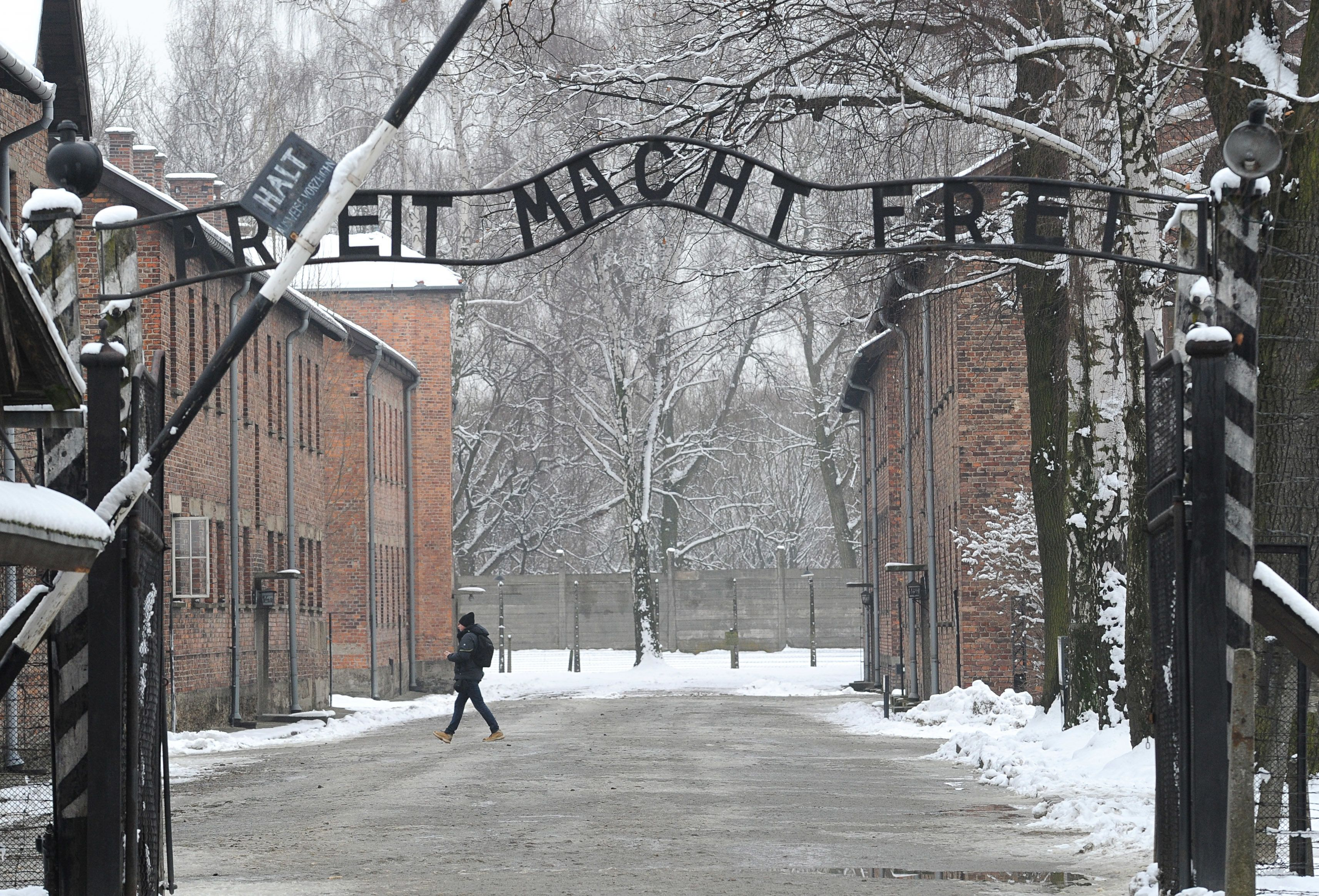 """The entrance to the former Nazi Death Camp Auschwitz with the """"Arbeit Macht Frei"""" (Work Sets you Free) writing above,  in Oswiecim, Poland, Monday, Jan. 26, 2015. (AP Photo/Alik Keplicz)"""