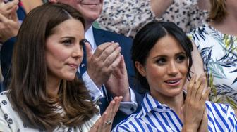 Photo by: KGC-178/STAR MAX/IPx 2018 7/14/18 Catherine, The Duchess of Cambridge, accompanied by Meghan, The Duchess of Sussex, in the royal box at Wimbledon where they watched the Ladies Final where Serena Williams was beaten by Angelique Kerber.