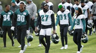 Philadelphia Eagles' safety Malcolm Jenkins, 27, walks off the field after an NFL training session at the London Irish rugby team training ground in the Sunbury-on-Thames suburb of south west London, Friday, Oct. 26, 2018. The Philadelphia Eagles are preparing for an NFL regular season game against the Jacksonville Jaguars in London on Sunday. (AP Photo/Matt Dunham)