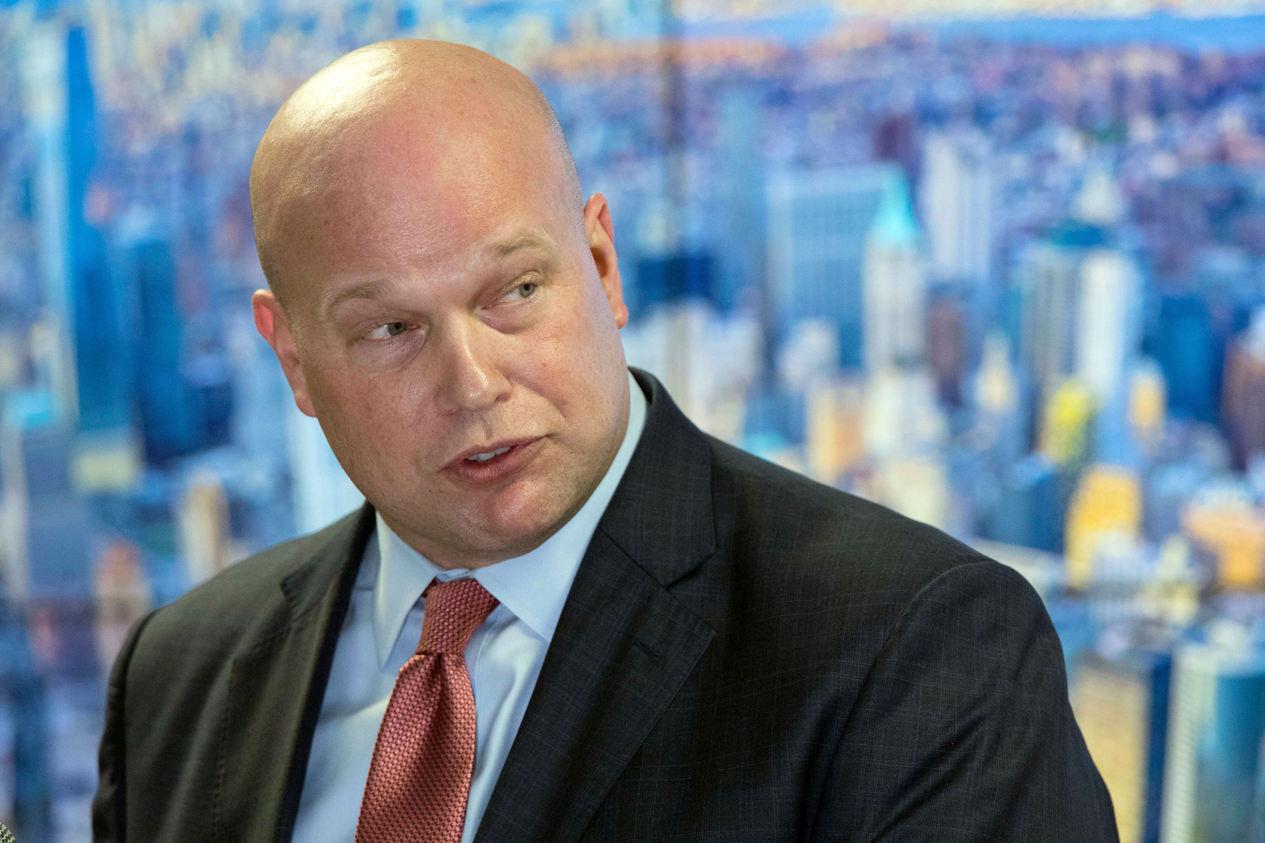 In this Nov. 21, 2018 photo, Acting Attorney General Matthew Whitaker, framed by a photograph of lower Manhattan, addresses law enforcement officials at the Joint Terrorism Task Force in New York. (AP Photo/Mary Altaffer)