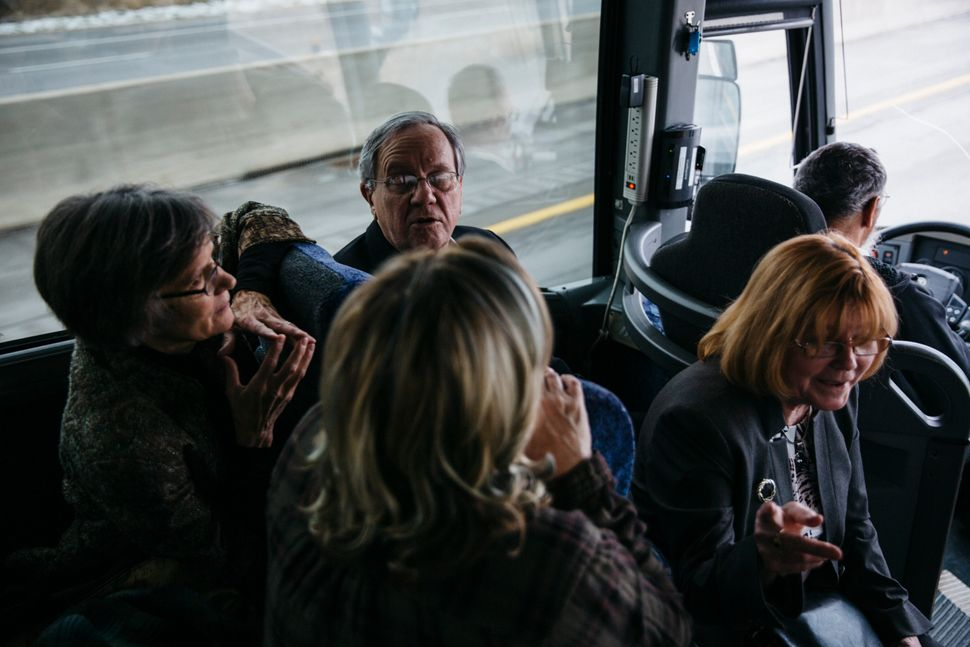 Gary Benjamin and Melody Hart talk with others on the bus ride from Ohio to the U.S. District Court in Ann Arbor, Michigan.