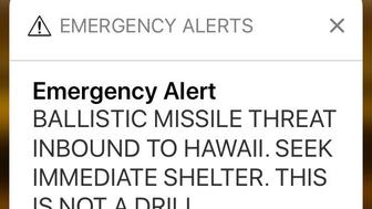 FILE - This Jan. 13, 2018 file smartphone screen capture shows a false incoming ballistic missile emergency alert sent from the Hawaii Emergency Management Agency system. A man who suffered a heart attack shortly after Hawaii mistakenly issued an alert about a ballistic missile is suing the state. The lawsuit filed in state court Tuesday, Nov. 27, 2018, said the sending of the false missile alert and failing to cancel it in a timely manner was a substantial factor in causing James Sean Shields' heart attack on Jan. 13. (AP Photo/Caleb Jones, File)