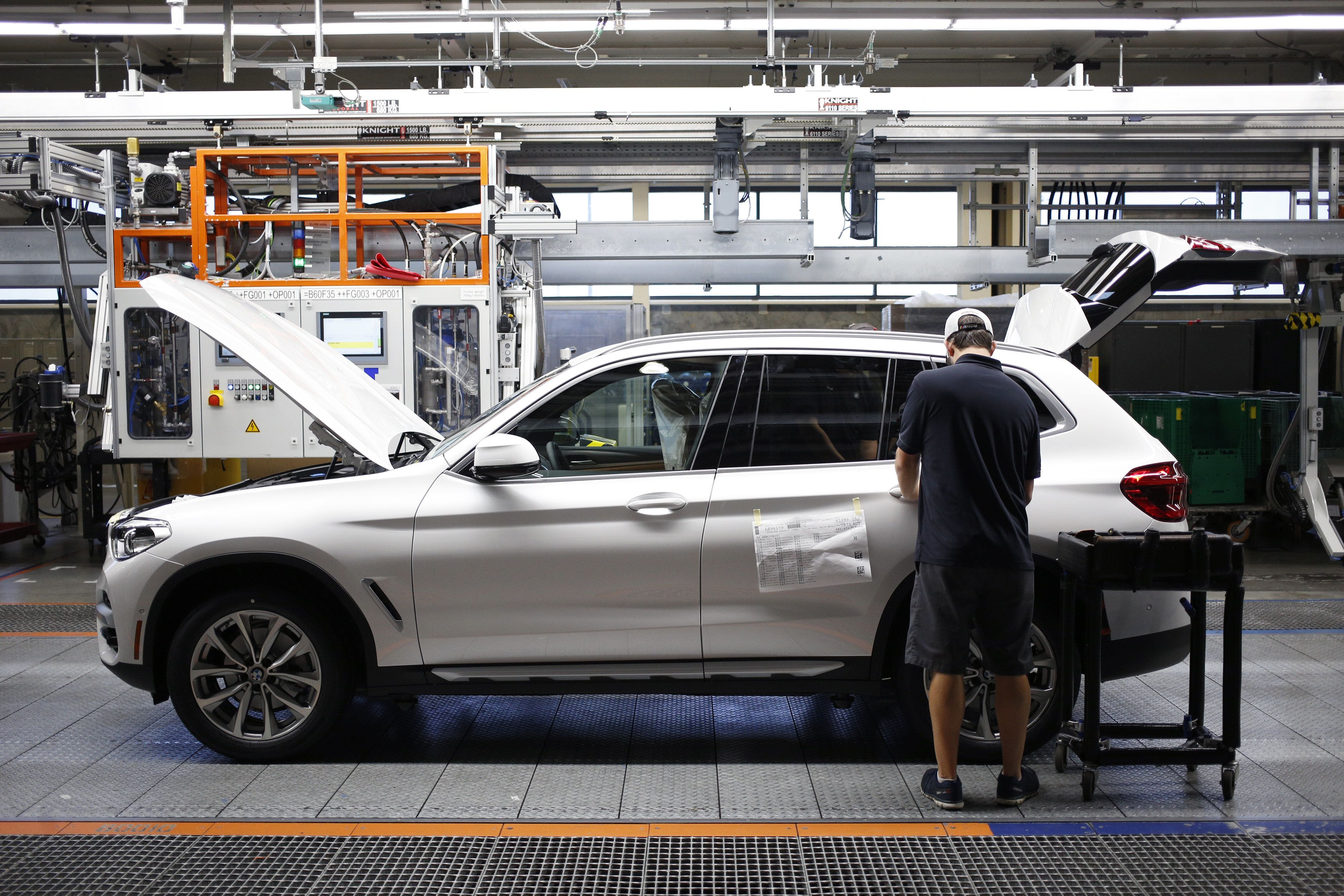 A worker at the BMW Manufacturing Co. factory in Greer, South Carolina, in May. In contradiction with President Donald Trump on November 29