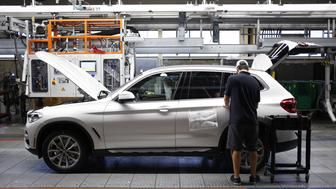A worker applies final touches on a Bayerische Motoren Werke AG (BMW) sports utility vehicle (SUV) on an assembly line at the BMW Manufacturing Co. plant in Greer, South Carolina, U.S. on Thursday, May 10, 2018. Markit is scheduled to release manufacturing figures on May 23. Photographer: Luke Sharrett/Bloomberg via Getty Images