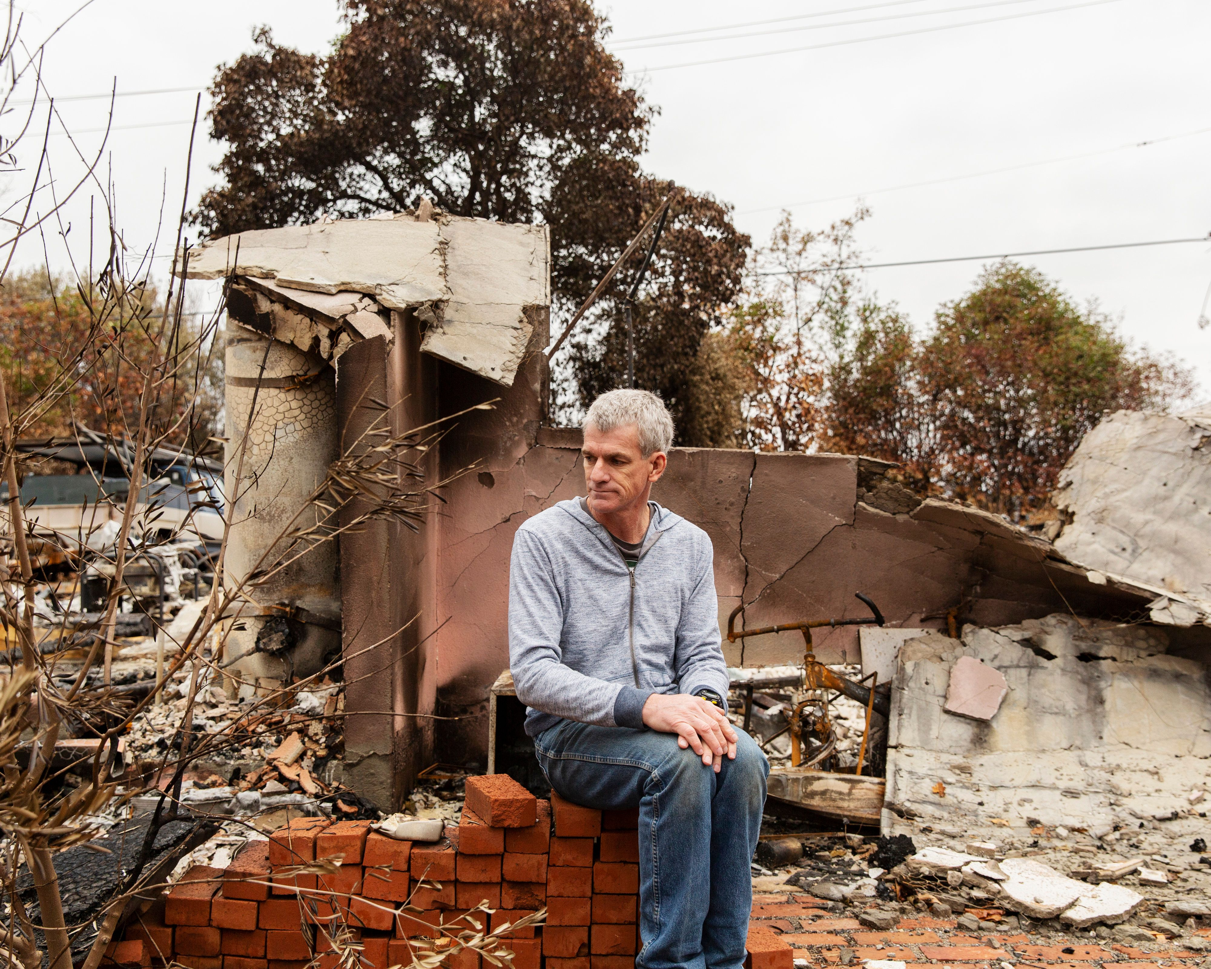 Robert Bean sits near the back porch area of one of his homes in Paradise, CA.  Images by Cayce Clifford