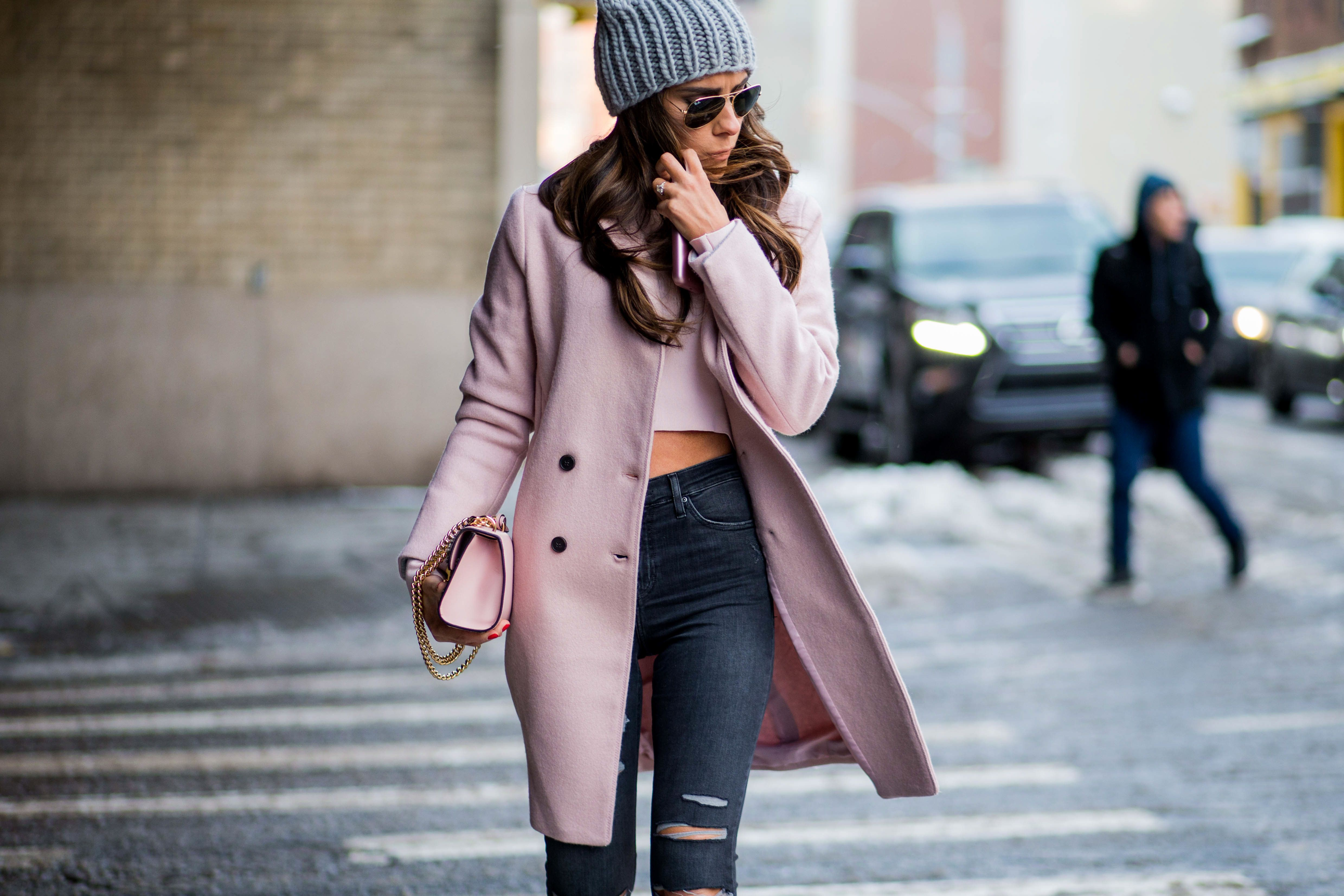 NEW YORK, NY - FEBRUARY 09:  A guest wearing a pink coat, beanie, pink top, denim jeans outside Noon by Noor on February 9, 2017 in New York City.  (Photo by Christian Vierig/Getty Images)