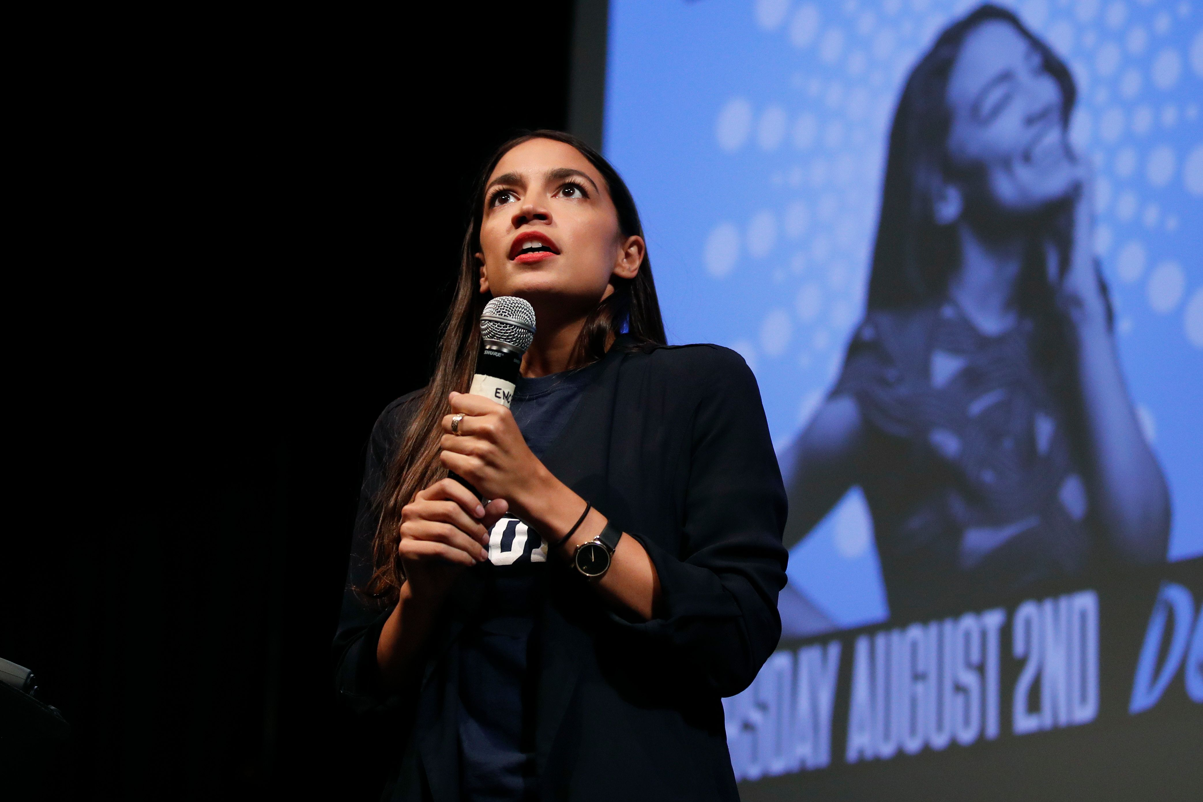 Alexandria Ocasio-Cortez, a winner of a Democratic Congressional primary in New York, addresses supporters at a fundraiser Thursday, Aug. 2, 2018, in Los Angeles. (AP Photo/Jae C. Hong)
