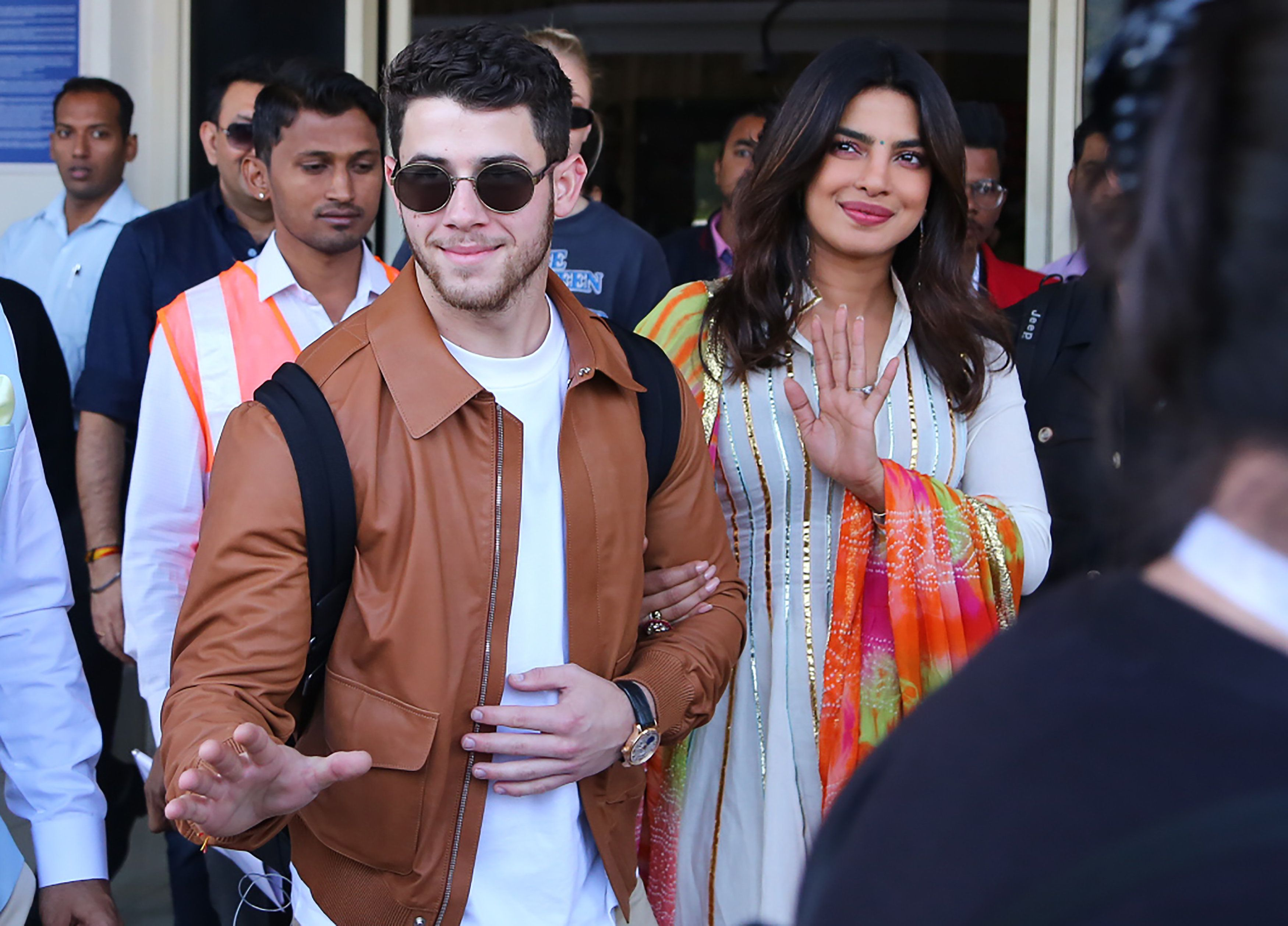 TOPSHOT - Indian actress Priyanka Chopra (R) and US musician Nick Jonas (centre L) arrive in Jodhpur in the western Indian state of Rajasthan on November 29, 2018. - Chopra and Jonas are set to be married in a series of ceremonies in Jodhpur. (Photo by Sunil VERMA / AFP)        (Photo credit should read SUNIL VERMA/AFP/Getty Images)