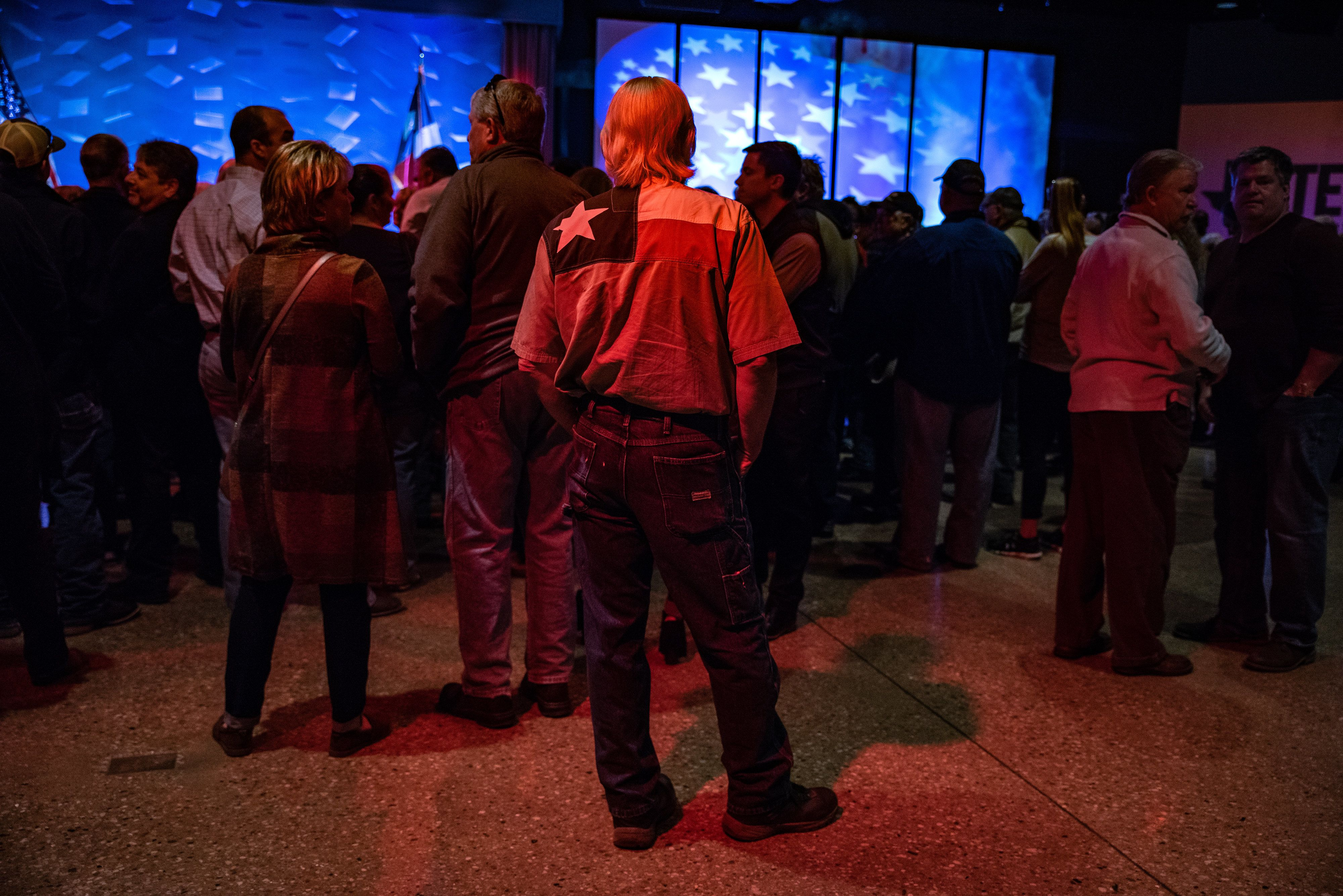 Attendees wait for the start of a campaign rally for Senator Ted Cruz, a Republican from Texas, in Fort Worth, Texas, U.S., on Friday, Nov. 2, 2018. Cruz is holding on to a narrow lead over Democratic challengerBeto O'Rourkeamong likely voters. Photographer: Sergio Flores/Bloomberg via Getty Images