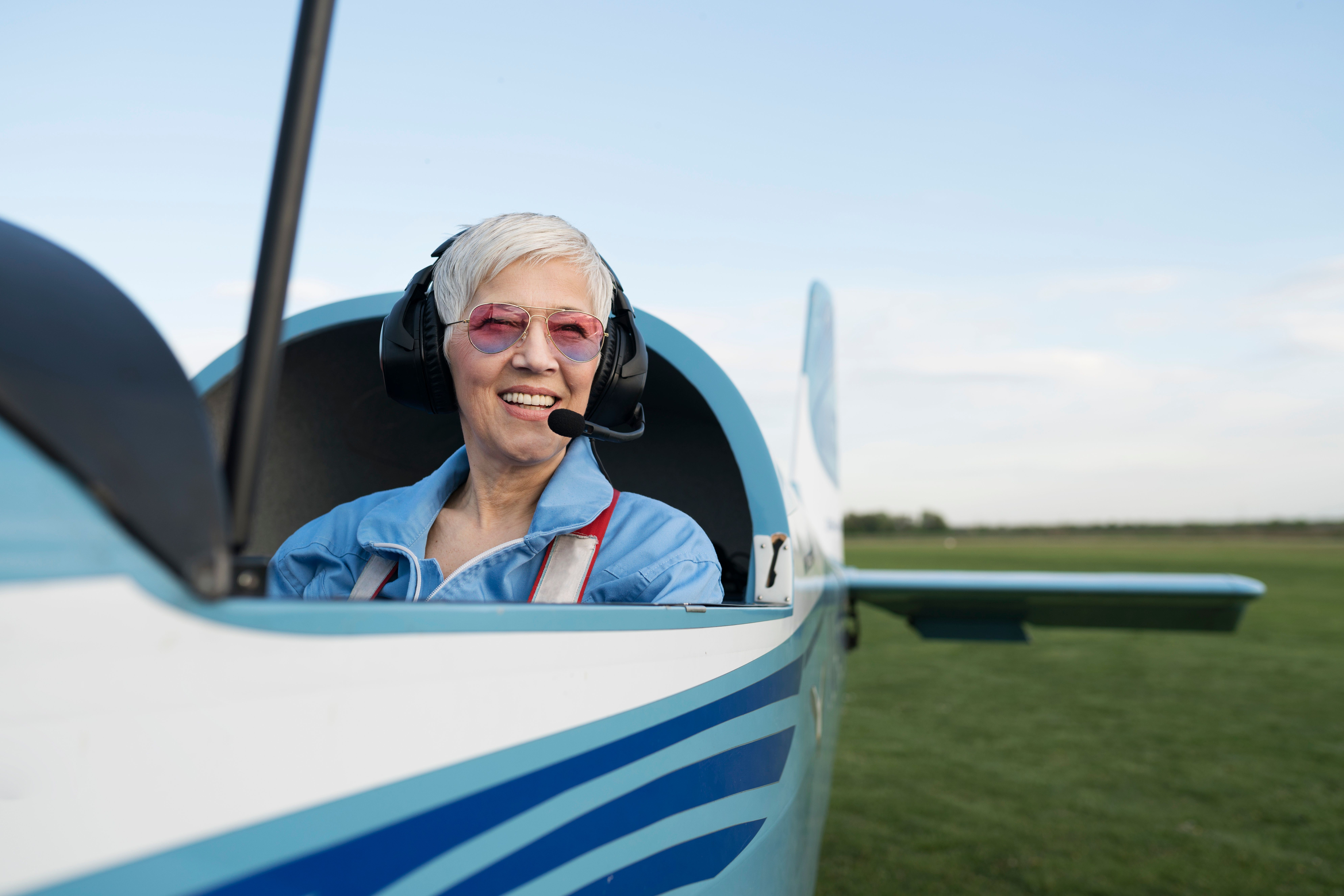 Woman pilot, preparing for flying