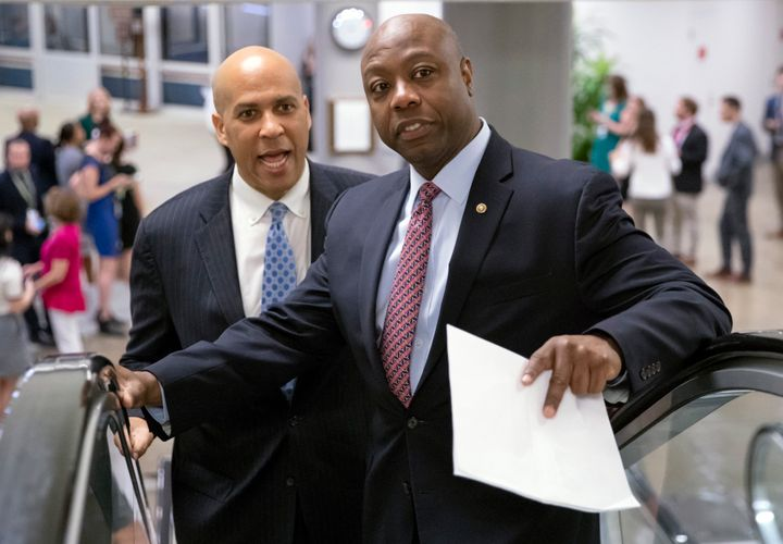 Sen. Tim Scott (R-S.C.), right, shown Aug. 23 at the Capitol with Sen. Cory Booker (D-N.J.), just sank President Donald Trump