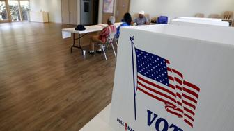 Election day in the precinct at St. Phillips Episcopal Church in Jackson, Miss., was very slow as workers wait for voters Tuesday afternoon, Aug. 25 2015. Hinds County is part of the state's Central District, and only has a Democratic runoff for transportation commissioner. (AP Photo/Rogelio V. Solis)
