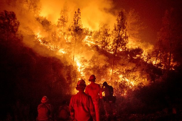 Firefighters battle the Ranch fire, part of the Mendocino Complex fire near Ladoga, California,