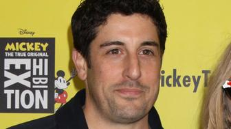 """Photo by: Victor Malafronte/STAR MAX/IPx 2018 11/7/18 Jason Biggs and his wife, Jenny Mollen at the grand opening of """"Mickey: The True Original Exhibition"""" in New York City."""