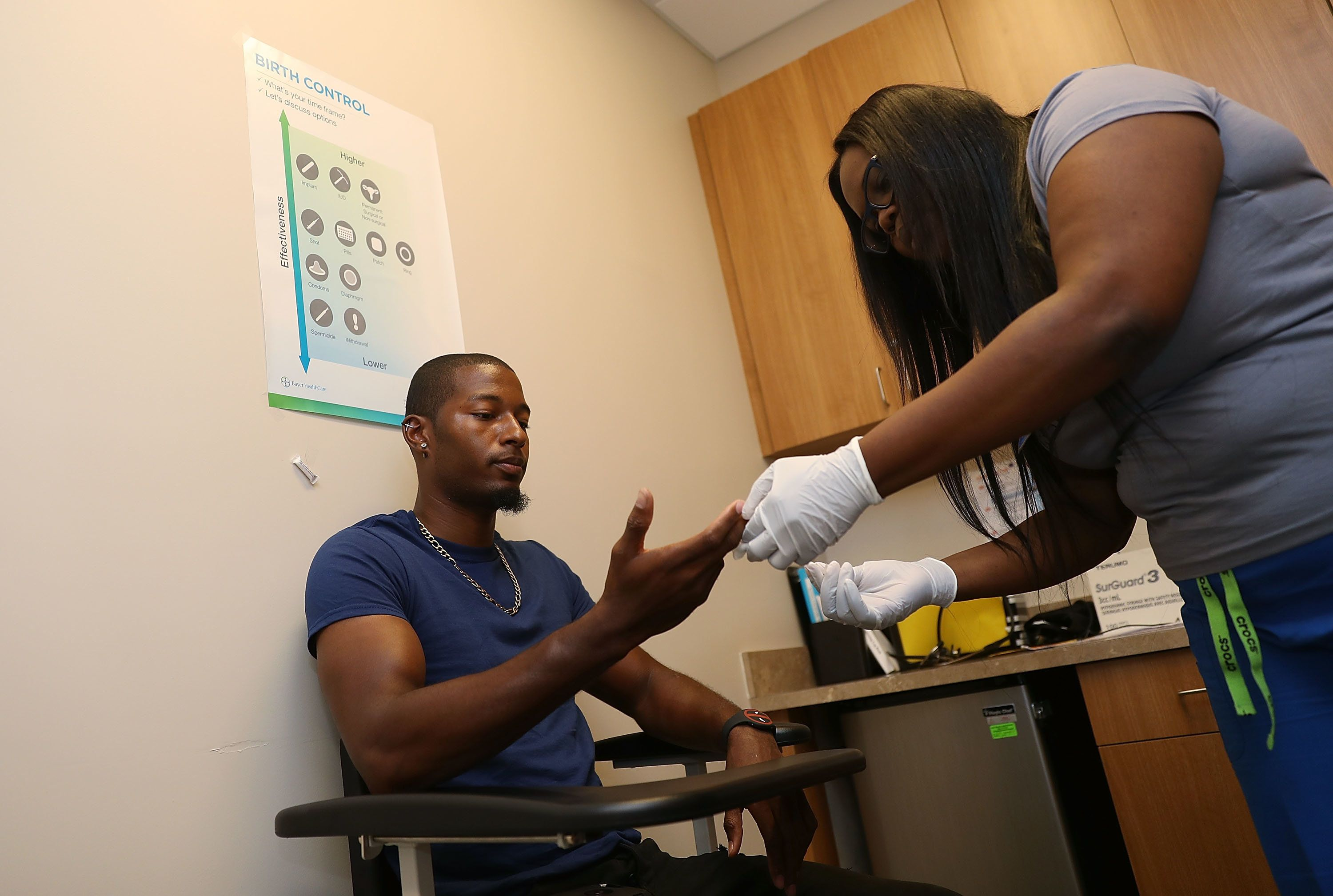 MIAMI, FL - JUNE 27:  Jamal Wilson has blood drawn from a finger as he receives a free HIV test from a medical assistant (who didn't want to provide her name) on National HIV Testing Day at a Planned Parenthood health center on June 27, 2017 in Miami, Florida. Planned Parenthood and other health care providers are offering the free service during the annual event in hopes of encouraging people to get tested for HIV and become educated about their status.  (Photo by Joe Raedle/Getty Images)