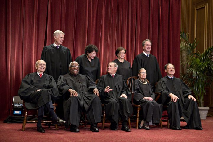 Seated from left to right in the bottom row are Associate Justice Stephen Breyer, Associate Justice Clarence Thomas, Chief Ju