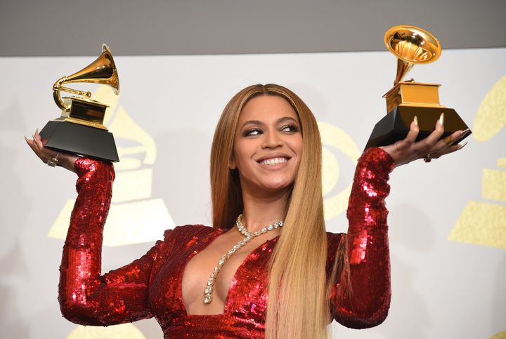 Beyoncé poses with her Grammys in the press room during the 59th Annual Grammy Awards on Feb. 12, 2017.
