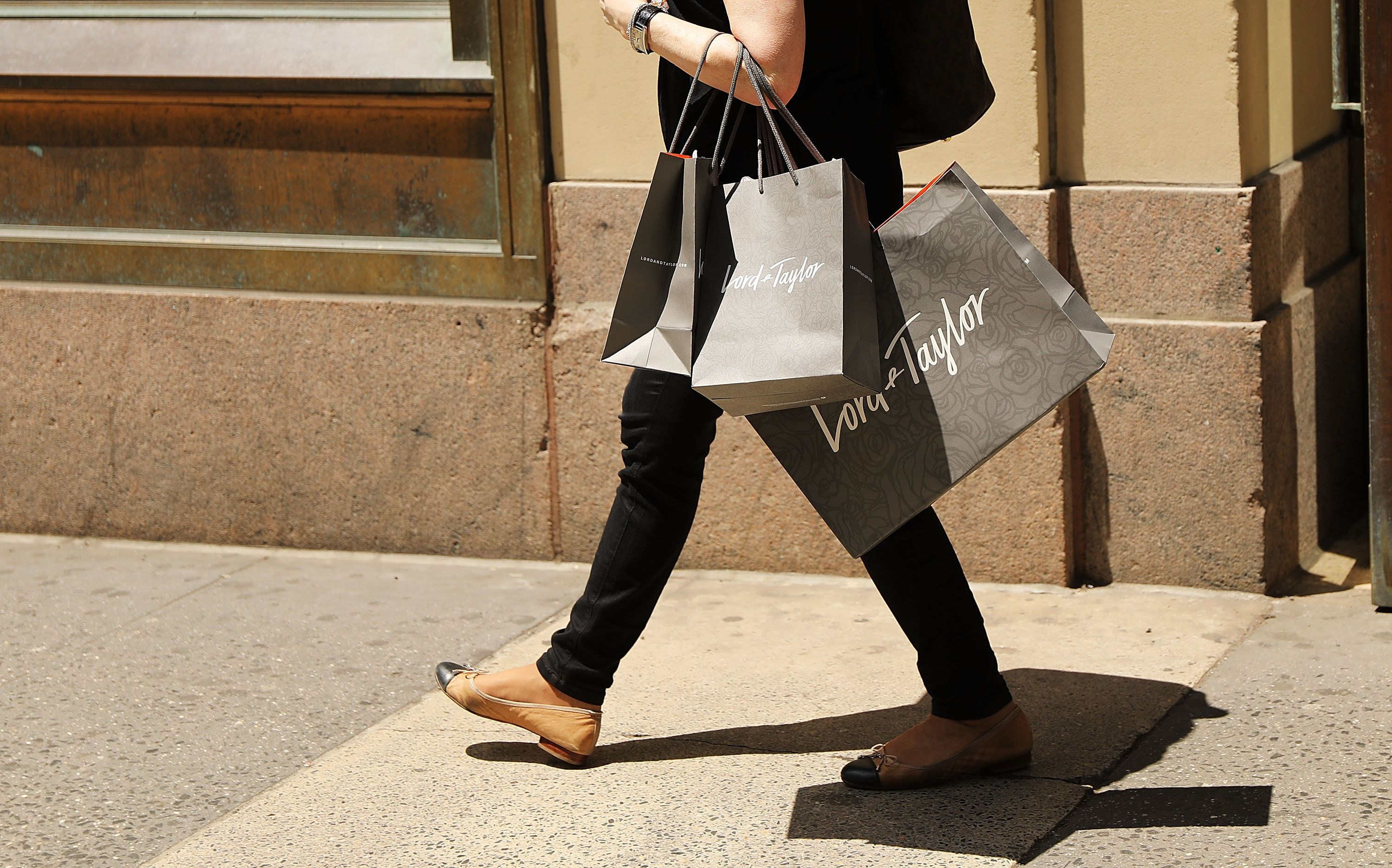 NEW YORK, NY - JUNE 06:  A woman walks out of Lord & Taylor's flagship store on 5th Avenue in Manhattan on June 6, 2018 in New York City. The 192-year-old chain owned by Canada's Hudson's Bay Co has announced Tuesday it was closing 10 of its 50 stores, including its iconic 5th Ave location.  (Photo by Spencer Platt/Getty Images)