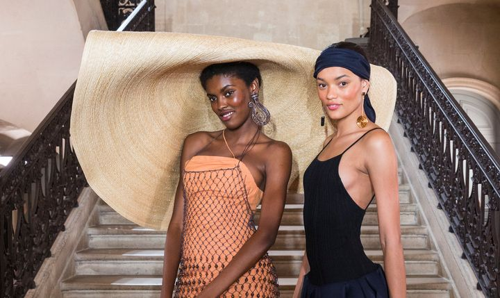 A model wears an extra-large hat at the Jacquemus spring/summer 2018 show.