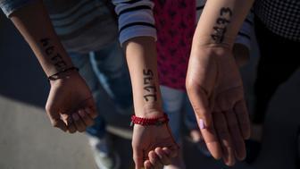 A representative from Grupos Beta walks a group of 30 asylum-seekers across the Paso Del Norte Port. (Adria Malcolm/Yahoo News)
