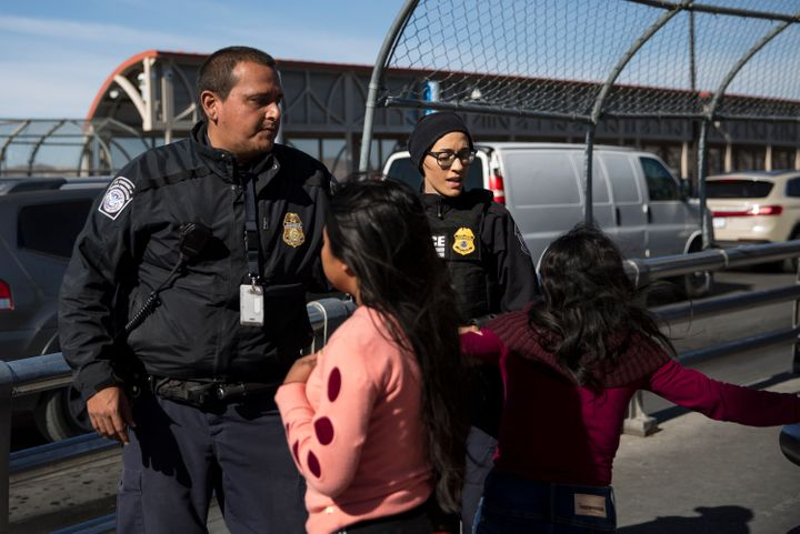 Customs and Border Patrol agents stop a woman and her daughter at the International Boundary Line of the Paso Del Norte Port