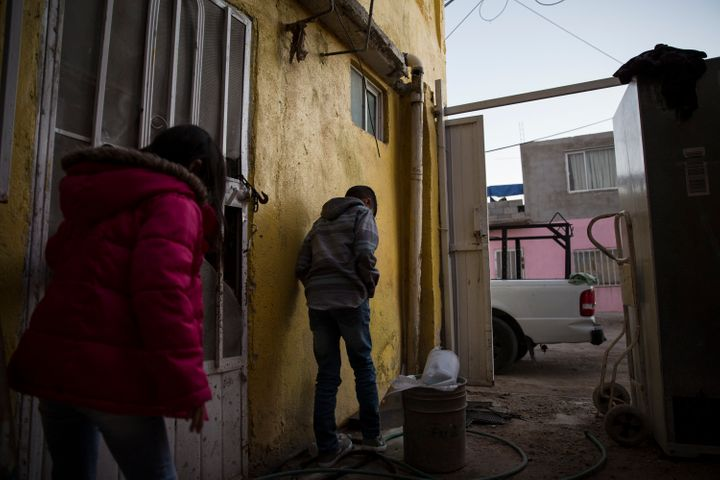 Lorena's children play outside in Juarez, Mexico after spending the day traveling from southern Mexico to seek asylum i