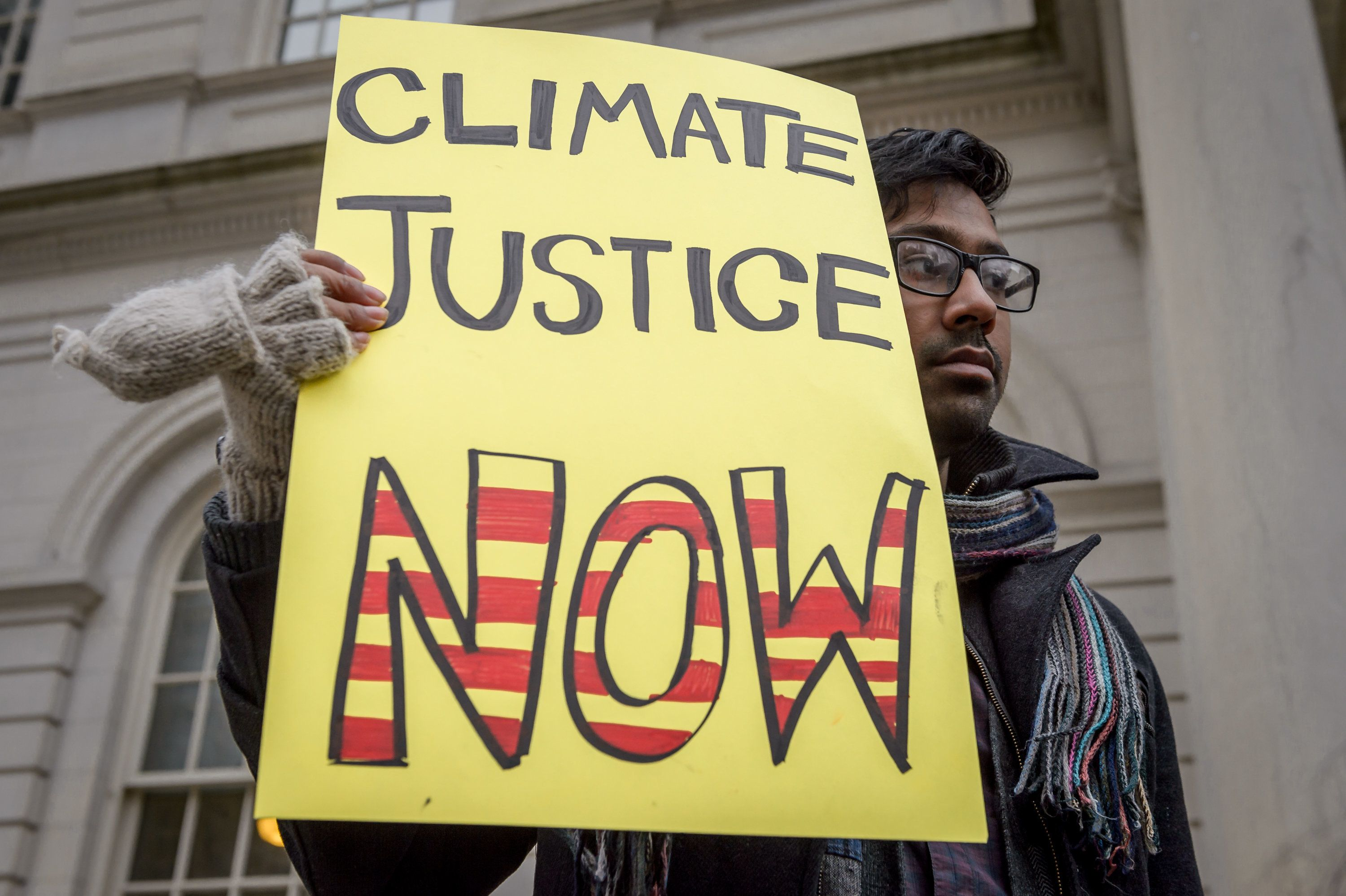 CITY HALL STEPS, NEW YORK, UNITED STATES - 2018/11/28: As global leaders assemble for the 4th Annual Climate Finance Day, New Yorkers, including representatives from environmental, community and student groups, held a rally at City Hall and call on NYC to divest public money from banks that fuel climate change and to establish a municipal public bank to help fund the transition to a just, sustainable economy. (Photo by Erik McGregor/Pacific Press/LightRocket via Getty Images)