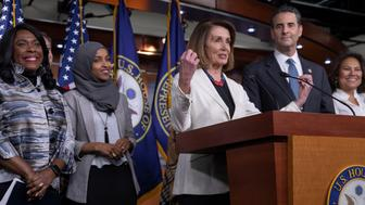 House Minority Leader Nancy Pelosi, D-Calif., center, is joined by fellow Democrats, from left, Rep. Terri Sewell, D-Ala., Rep.-elect Ilhan Omar, D-Minn., Rep. John Sarbanes, D-Md., and Rep.-elect Veronica Escobar, D-Texas, at a news conference to discuss their priorities when they assume the majority in the 116th Congress in January, at the Capitol in Washington, Friday, Nov. 30, 2018. (AP Photo/J. Scott Applewhite)