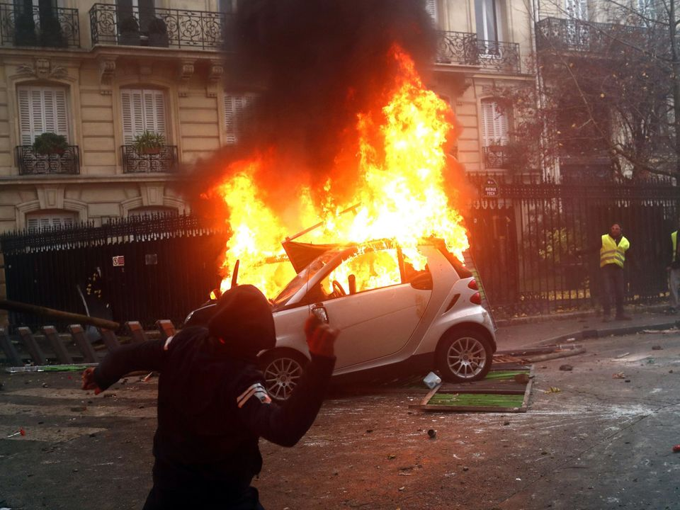 French Protestors Have Stolen An Assault Rifle From A Police Van In