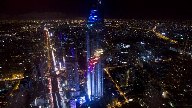 BANGKOK, THAILAND - 2016/08/29: MahaNakhon building in the Silom district of Bangkok lights up during...