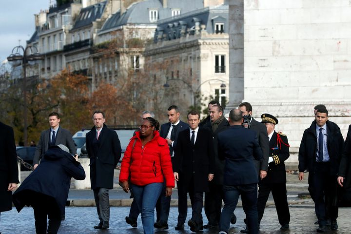 French President Emmannuel Macron leaves the Arc de Triomphe on Sunday after inspecting damage during Saturday's riots.