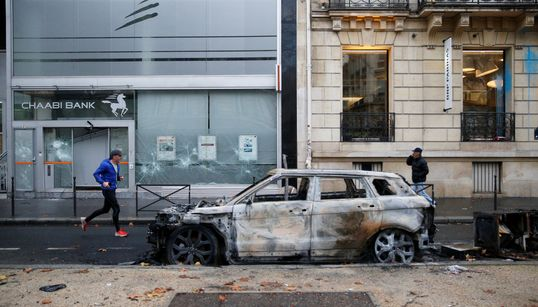Stunned Parisians Clean Up Posh Streets After Worst Riots Since