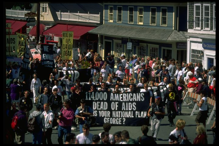 Protesters march near George H.W. Bush's vacation home in Kennebunkport, Maine, in September 1991.