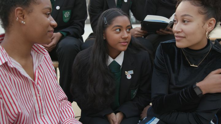 Renée, left, and Dania, right, with pupils from Elmgreen School.