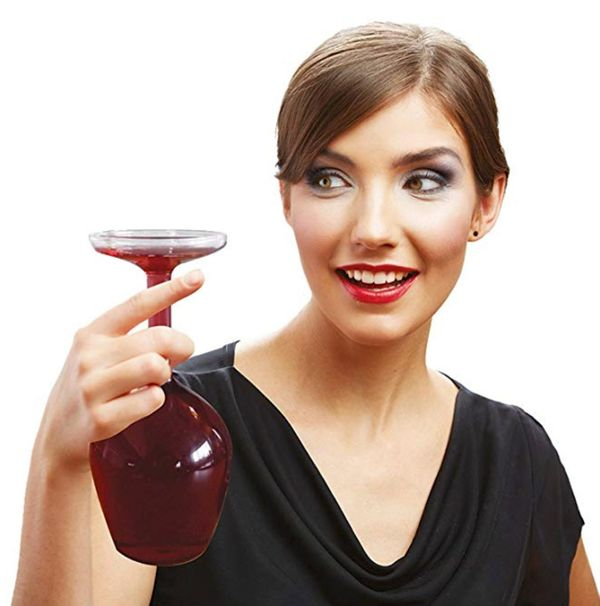 "Love can be topsy turvy, so shouldn't your<a href=""https://sellwild.com/itemDetail/upside_down_wine_glass_104280303"" target="""