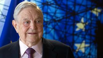 FILE - In this Thursday, April 27, 2017 file photo, George Soros, Founder and Chairman of the Open Society Foundation, waits for the start of a meeting at EU headquarters in Brussels. The Budapest-based Central European University, founded by billionaire George Soros, says the school will begin recruiting students for the 2019-2020 academic year and plans to stay in Budapest. (Olivier Hoslet, Pool Photo via AP)