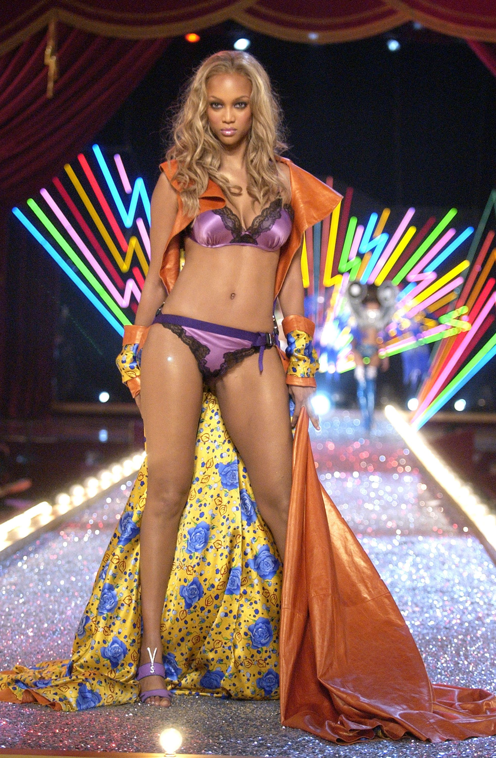 03b76ca0b2 Tyra banks iconic style moments from the to now huffpost life jpg 960x1465  Tyra banks purple