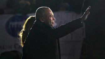Massachusetts Gov. Deval Patrick walks with his wife Diane, behind, and waves to well wishers as he departs the Statehouse, Wednesday, Jan. 7, 2015, in Boston. Mass. Governor-elect Charlie Baker is to succeed Patrick following his inauguration Thursday, Jan. 8. (AP Photo/Steven Senne)
