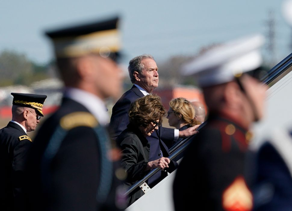 George W. Bush and Laura Bush head up the stairs to the plane after the casket was placed on board at Ellington Field in Hous