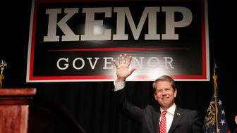 Georgia Republican gubernatorial candidate Brian Kemp waves before speaking to supporters Wednesday, Nov. 7, 2018, in Athens, Ga. (AP Photo/John Bazemore)