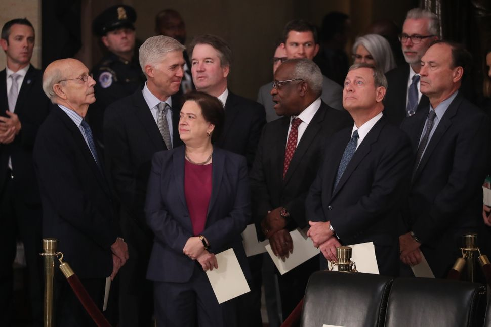 Supreme Court Justices Stephen Breyer, Neil Gorsuch, Elena Kagan, Brett Kavanaugh, Clarence Thomas, John Roberts and Sam