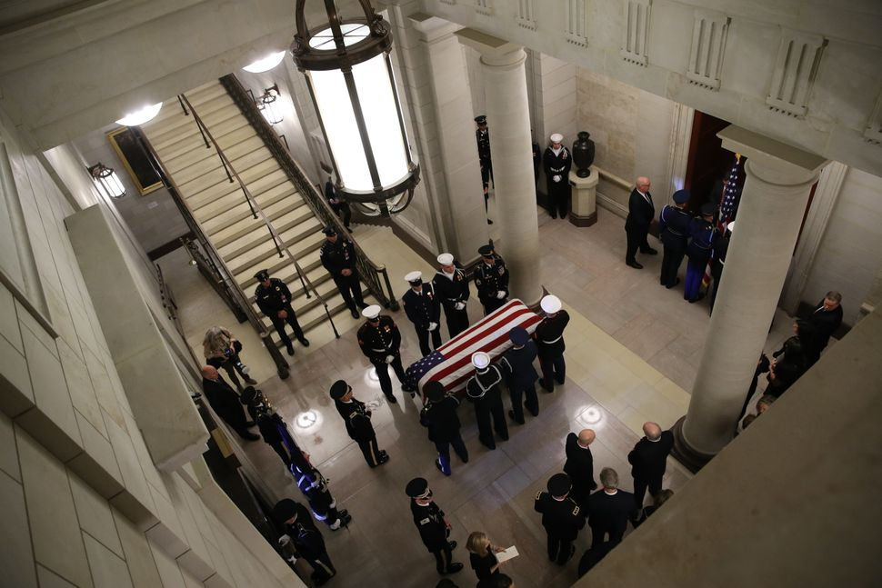 A military honor guard with Bush's casket inside the Capitol.
