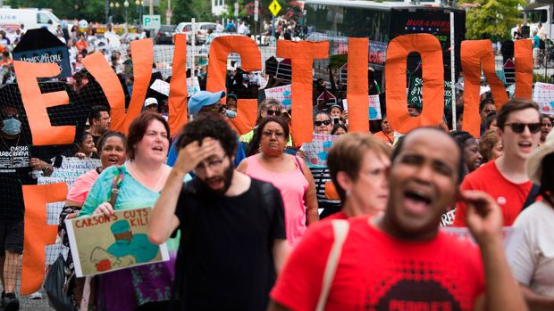 Demonstrators chant during a march with low-income tenants, housing advocates and community leaders from across the country protesting the 'proposed billions in cuts to federal housing programs' by the administration of US President Donald Trump,  in Washington, DC, on July 12, 2017.   / AFP PHOTO / JIM WATSON        (Photo credit should read JIM WATSON/AFP/Getty Images)