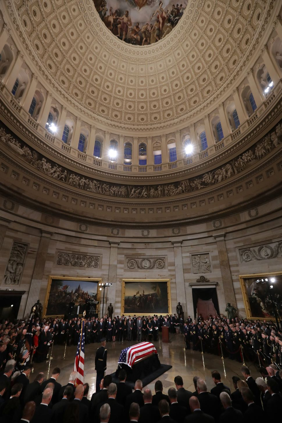 Bush's flag-draped casket lies in state inside the Capitol Rotunda.