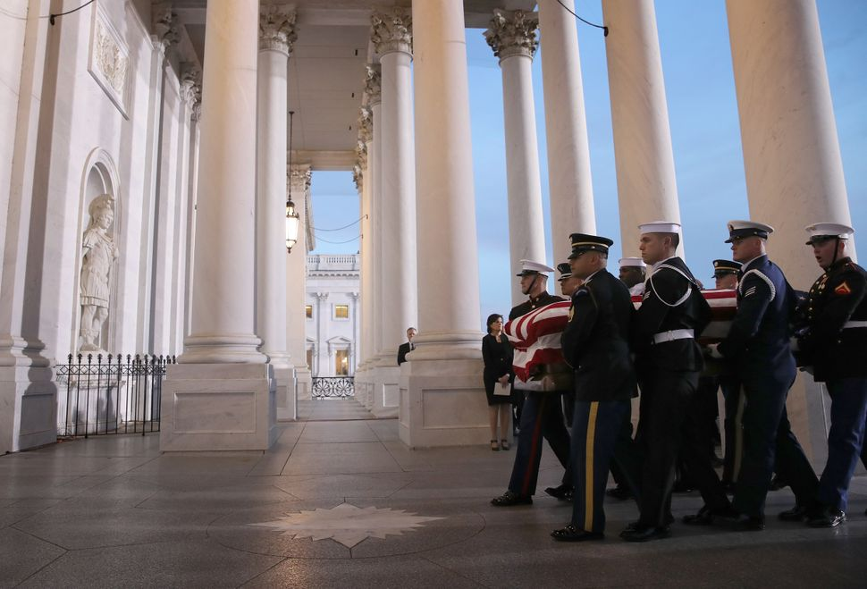 A military honor guard carries Bush's casket into the Capitol.