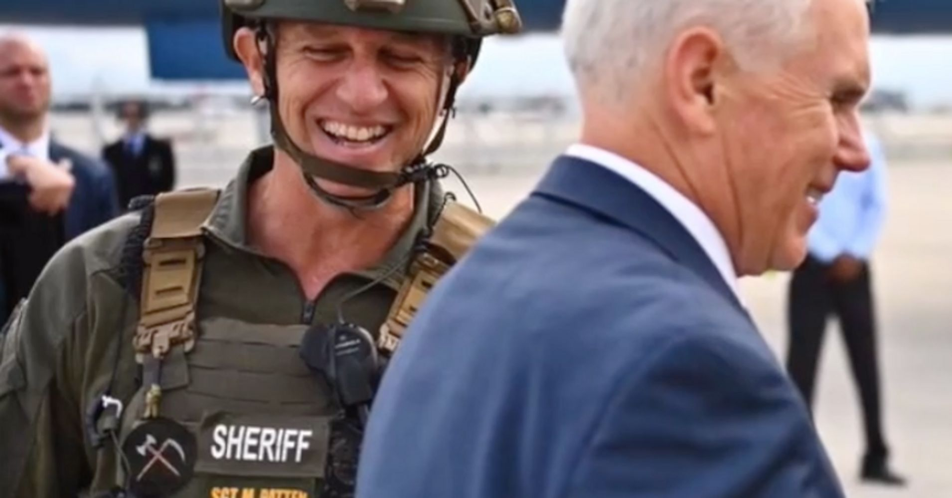 Florida SWAT Officer Demoted After Wearing QAnon Patch In Photo With Mike Pence