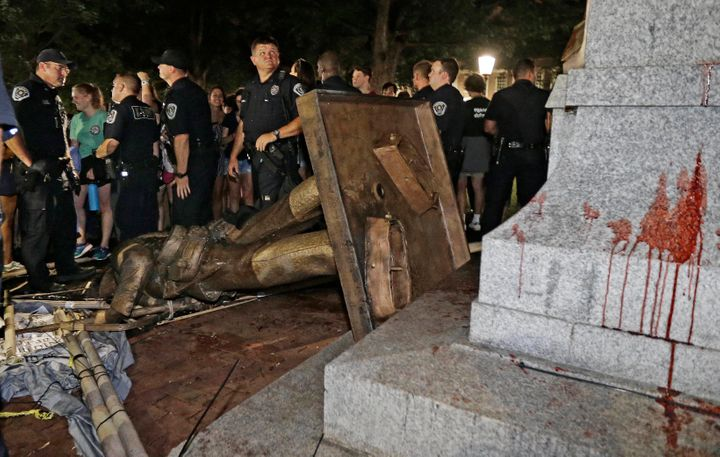Silent Sam lies on its side after protesters toppled the Confederate monument on Aug. 20.