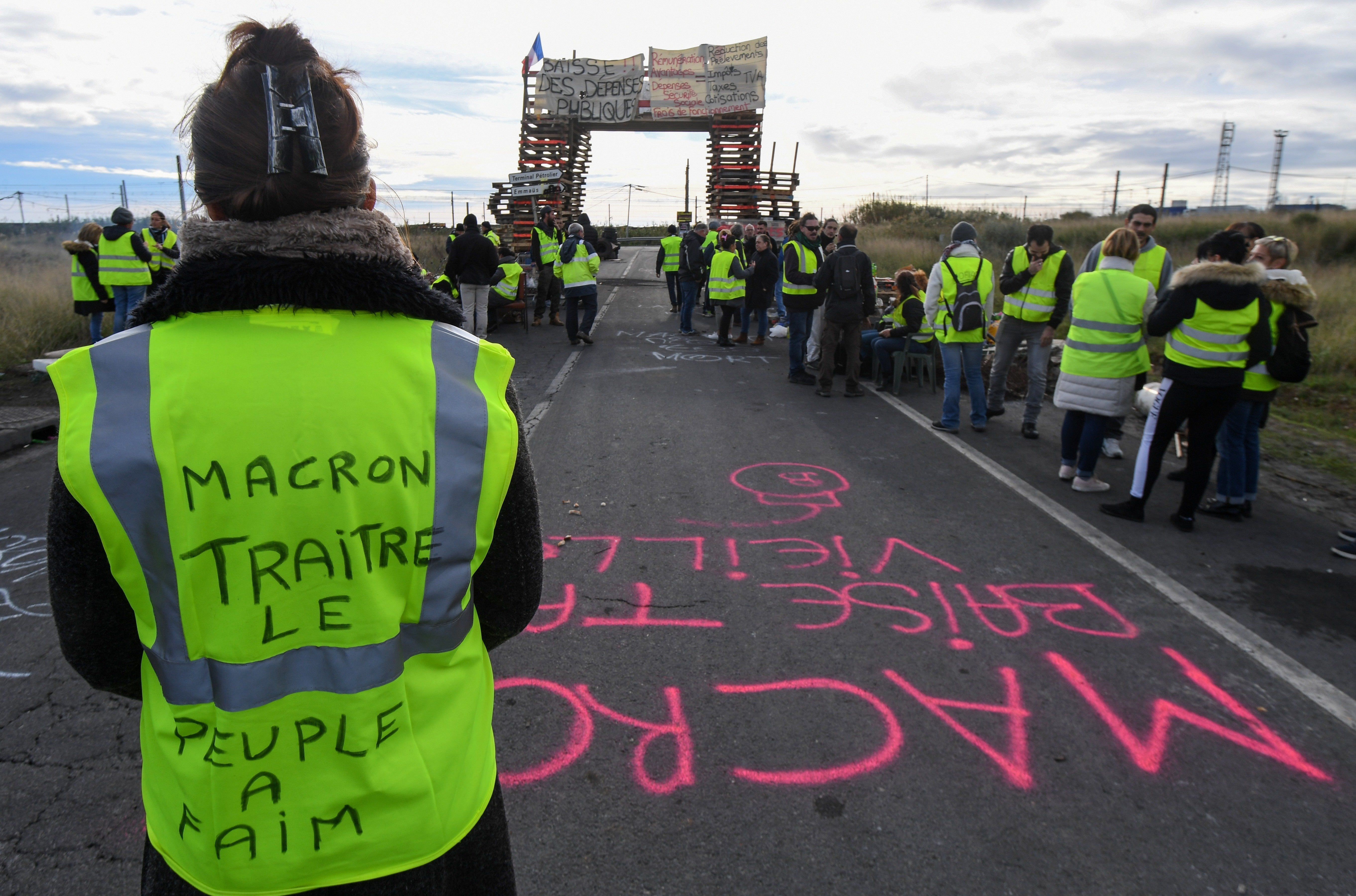 Macron Set To Suspend Fuel Tax Increase To End French 'Yellow Vest'
