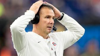 FILE - In this Dec. 1, 2018, file photo, Ohio State head coach Urban Meyer watches from the sidelines during the first half of the Big Ten championship NCAA college football game against Northwestern, in Indianapolis. Ohio State says Urban Meyer will retire after the Rose Bowl and assistant Ryan Day will be the next head coach. After seven years and a national championship at Ohio State, the 54-year-old Meyer will formally announce his departure Tuesday, Dec. 4, 2018, at a news conference. The university didn't say why he was retiring, but Meyer has said he suffers from debilitating headaches caused by an arachnoid cyst in his brain. (AP Photo/AJ Mast, File)