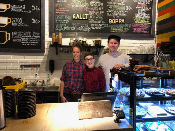 Jessica Schock, center, 28, with her co-workers atBjöhrns Cafe in Kiruna, Sweden.